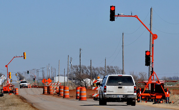 Temporary traffic lights helps the flow of traffic on Southgate Road Sunday. A portion of Southgate is being moved to accommadate the expansion of a runway at Woodring Airport. (Staff Photo by BILLY HEFTON)