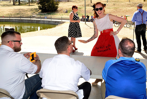 Pin-up girl winner, Cameron Kaiser, wooes the judges during the 2014 Mustache Saturday at Government Springs Park. (Staff Photo by BILLY HEFTON)