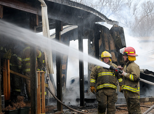 Firefighters from Lahoma, Drummond, Hillsdale-Carrier, Major County, Meno, Ringwood and Waukomis battle a house fire in Lahoma Wednesday, March 5, 2014. The body of an unidentified victim was found at the scene. (Staff Photo by BONNIE VCULEK)
