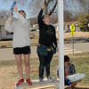 Marquette University students,(left to right) Erin Healey, Sarah Weiss and Nic Schmidt, work on a house being built by Habitat for Humanity Friday. (Staff Photo by BILLY HEFTON)