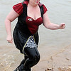 Tammy Wilson (right), portrays the Queen of Hearts, as she finishes her plunge into Crosslin Park Lake during the 7th annual Warren Edds Memorial Civitan Chiller Challenge Saturday, March 01, 2014. (Staff Photo by BONNIE VCULEK)