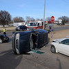 Enid police officers work the scene of a three car accident Friday east of the intersection of Willow and Van Buren. (Staff Photo by BILLY HEFTON)