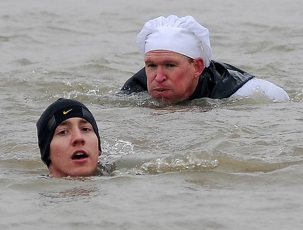 Kent Olson and Eric Brunken swim Crosslin Park Lake during the 7th annual Warren Edds Memorial Civitan Chiller Challenge at Awaken the Fire Church Saturday, March 1, 2014. (Staff Photo by BONNIE VCULEK)