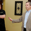 Dr. Scott Williams (left), Chief Medical Officer, and Brian Hayden (right), President of Xpress Wellness Urgent Care, take turns answering questions before the new clinic in Enid opens Wednesday, March 12, 2014. Clients may schedule an appointment online. (Staff Photo by BONNIE VCULEK)