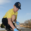 Ty Schlecht picks up cigarette butts at Meadowlake Park Saturday as part of the national campaign Kicks Butts Day. (Staff Photo by BILLY HEFTON)