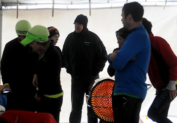 Endurance runners keep warm near an infrared heater between their 6-mile loops during the All Day Run for Autism at Groendyke Lodge Saturday, March 8, 2014. (Staff Photo by BONNIE VCULEK)