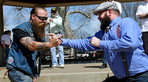 Travis Nance (right) and Eddie Mercury compete in the manly sport of finger jousting during the 2014 Mustache Saturday at Government Springs Park. (Staff Photo by BILLY HEFTON)