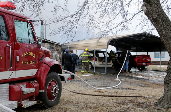 Lahoma Fire Department battles a house fire where an unidentified victim perished Wednesday, March 5, 2014. Fire departments from Drummond, Hillsdale-Carrier, Meno, Major County, Ringwood and Waukomis helped Lahoma firefighters bring the blaze under control. Lahoma Police Department, Garfield County Sheriff's Department, Life EMS and Garfield County Emergency Management also responded to the scene. (Staff Photo by BONNIE VCULEK)