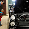 Ken Walker looks over a Mustang with his grandson, Lane, Saturday at the Cimarron Council Boy Scouts of America Car Show at the Chisholm Trail Expo Center. (Staff Photo by BILLY HEFTON)