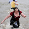 Tammy Wilson (right), portrays the Queen of Hearts, as she takes the plunge into Crosslin Park Lake during the 7th annual Warren Edds Memorial Civitan Chiller Challenge Saturday, March 01, 2014. (Staff Photo by BONNIE VCULEK)