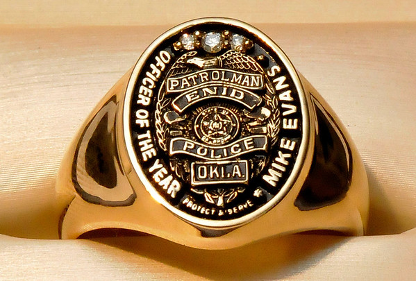 A custom made ring from Jackson Diamond Jewelers that was presented to Enid police officer, Mike Evans, for being named Officer of the Year. (Staff Photo by BILLY HEFTON)