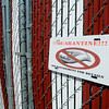 Quarantine signs hang on outside kennels at the SPCA as part of new measures being taken to help prevent the spread of iinfectious diseases. (Staff Photo by BILLY HEFTON)