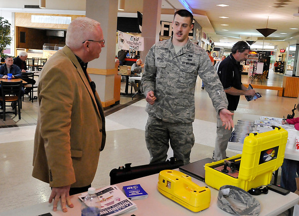 A1C Steven Moxley discusses emergency procedures during the Garfield County Emergency Management's Weather and Disaster Preparedness Day at Oakwood Mall Saturday. (Staff Photo by BILLY HEFTON)