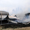 Firefighters from Lahoma, Drummond, Hillsdale-Carrier, Major County Rural Water, Meno, Ringwood and Waukomis battle a house fire in Lahoma Wednesday, March 5, 2014. The body of an unidentified victim was found at the scene. (Staff Photo by BONNIE VCULEK)