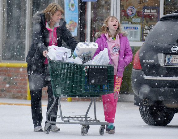 A girl tries to catch a snowflake on her tougue as the sleet turned to snow Sunday afternoon. (Staff Photo by BILLY HEFTON)
