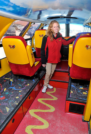 Hotdogger, Molly Segall, stands inside the Oscar Meyer Wienermobile Thursday at Jumbo's West. (Staff Photo by BILLY HEFTON)