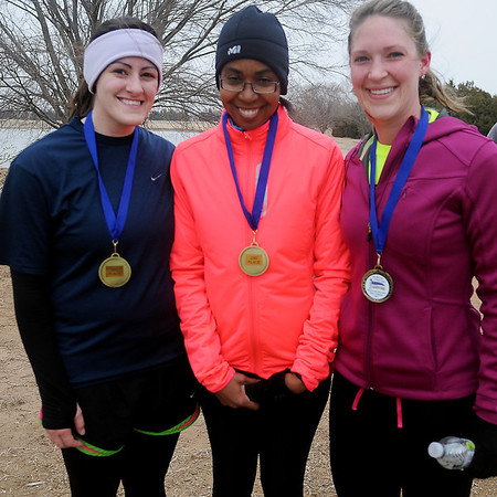 Chelsea Barron, Denarius Brittain and Anna Helmkamp (from left) placed third, second and first respectively during the 5K run at the 7th annual Warren Edds Memorial Civitan Chiller Challenge Saturday, March 1, 2014. (Staff Photo by BONNIE VCULEK)