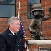 Enid Fire Chief Joe Jackson addresses those attending the dedication ceremony for a statue of Sparky the Dog in memory of former Enid Fire Chief Phillip Clover Friday. (Staff Photo by BILLY HEFTON)