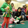 Toddlers dance to music during one of the children's programs at the Public Library of Enid and Garfield County Wednesday, March 5, 2014. (Staff Photo by BONNIE VCULEK)