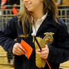 Kate Birkenfeld, from Timberlake FFA, smiles after her championship placing with her Berkshire barrow during the 80th annual Northwest District Junior Livestock Show at the Chisholm Trail Expo Center Saturday, March 8, 2014. (Staff Photo by BONNIE VCULEK)