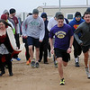 Oklahoma Representative Mike Jackson (left) blasts an air horn as runners begin the Yes We Can Civitan Club 5K run Saturday, March 1, 2014. (Staff Photo by BONNIE VCULEK)