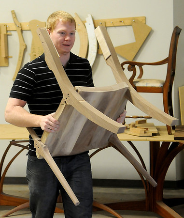Joe Lamerton, a local custom woodworker, designs and creates his unique furniture at the James W. Strate Center for Business Development Friday, March 7, 2014. Lamerton has been participated in the incubator program for the past few months. (Staff Photo by BONNIE VCULEK)