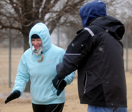 Desiree Powell receives congratulations from Glenn McDaniel as Powell completes her second, 6-mile loop at Groendyke Lodge during the All Day Run for Autism Saturday, March 8, 2014. Runner will continue their endurance loops until 3 p.m. Sunday. (Staff Photo by BONNIE VCULEK)