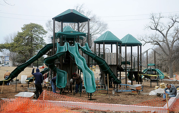 Workers from Child's Play, Inc. install the new playground at Glenwood Park Friday, March 7, 2014. New play areas at have now been built at Champion, Champlin, Government Springs, Don Haskins, Glenwood and Meadowlake Parks in Enid. (Staff Photo by BONNIE VCULEK)