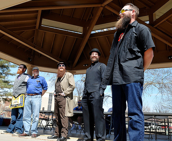The 2014 Mustache March Ambassadors, (Left to right) Justin Winbolt, Robert Barron, Jeff Molnar, Robert Beurlot and Brian Kaiser on stage Saturday at Government Springs Park. (Staff Photo by BILLY HEFTON)