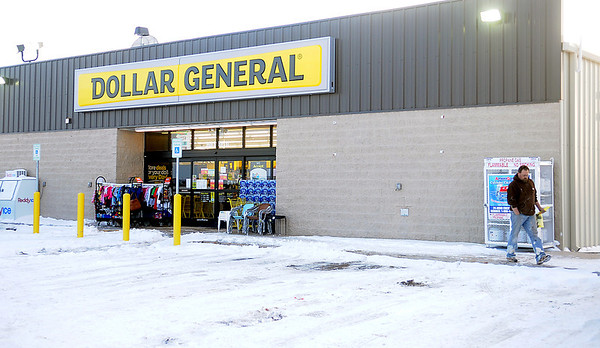 A shopper leaves the new Dollar General in Waukomis Monday, March 03, 2014. (Staff Photo by BONNIE VCULEK)