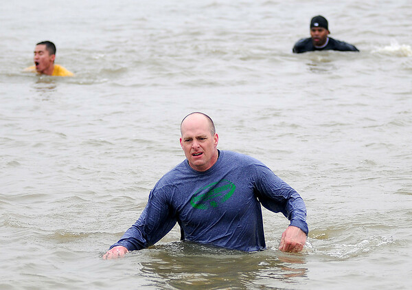 Col. Darren James (center), commander of the 71st Flying Training Wing at Vance Air Force Base, takes the plunge during the 7th annual Warren Edds Memorial Civitan Chiller Challenge at Crosslin Park Lake Saturday, March 1, 2014. Proceeds from the event support special olympics competitions at Vance Air Force Base each year. (Staff Photo by BONNIE VCULEK)