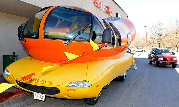 Traffic passes the Oscar Meyer Wienermobile Thursday at Jumbo's West. (Staff Photo by BILLY HEFTON)