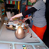 Bethany Conner, of the Oklahoma Museum Network, demostrates the robot dummie inside the Science Matters truck at Leonard's Children's Museum Monday. (Staff Photo by BILLY HEFTON)