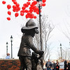 Balloon release during the dedication ceremony for a statue of Sparky the Dog in memory of former Enid Fire Chief Phillip Clover Friday. (Staff Photo by BILLY HEFTON)