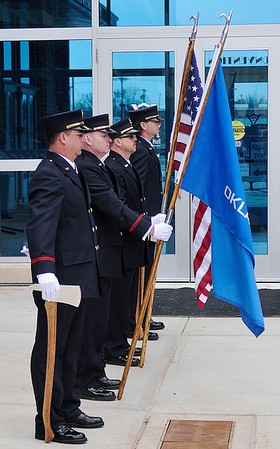 Enid Fire Department Honor Guard at the conclusion of a dedication ceremony for a statue of Sparky the Dog in memory of former Enid Fire Chief Phillip Clover Friday. (Staff Photo by BILLY HEFTON)