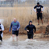 Swimmers take Crosslin Park Lake Island during the 7th annual Warren Edds Memorial Civitan Chiller Challenge Saturday, March 1, 2014. (Staff Photo by BONNIE VCULEK)