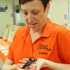 Andrine Shufran, Insect Adventure coordinator for the Oklahoma State University Dept. of Entomology and Plant Pathology, holds an Emperor Scorpion from Africa during a presentation at Waller Middle School Tuesday, March 11, 2014. (Staff Photo by BONNIE VCULEK)
