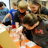 Waller Middle School students take a close look at several exotic insects from the Oklahoma State University Department of Entomology and Plant Pathology Tuesday, March 11, 2014. Waller PTSA sponsored the event.  (Staff Photo by BONNIE VCULEK)