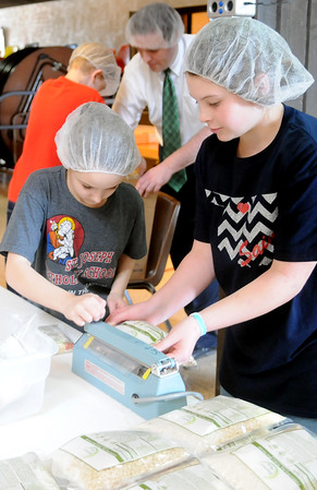 St. Joseph Catholic School students seal and pack 20,000 meals as their lenten community service project for Kids Against Hunger Northwest Oklahoma Friday, March 13, 2015. The meals will be delivered to Haiti by Monte Stewart during the students' spring break March 16-20. (Staff Photo by BONNIE VCULEK)