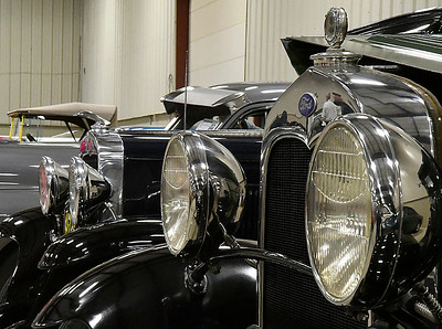 Headlights on two antique cars at the Boy Scouts of America Car Show Saturday March 25, 2017 at the Chisholm Trail Expo Pavillon. (Billy Hefton / Enid News & Eagle)