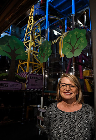 Tracy Bittle, new executive director of Leonardo's Children's Museum, stands in front of the Power Tower Wednesday March 15, 2017. (Billy Hefton / Enid News & Eagle)