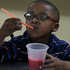 Micaiah Redman savors a frozen strawberry lemonade in cooking club during after school activities at Zoe Bible Church Friday March 3, 2017. (Billy Hefton / Enid News & Eagle)