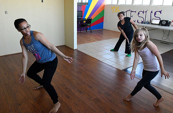 LaShandria Redman (left) leads Shakara Revels and Jaelynn Jordan in dance club during after school activities at Zoe Bible Church Friday March 3, 2017. (Billy Hefton / Enid News & Eagle)
