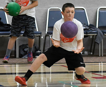 James Humphrey catches a ball during a KLife dodgeball tournament Saturday March 25, 2017 at Oakwood Christian Church. (Billy Hefton / Enid News & Eagle)