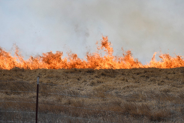 Wind driven flames of a grass along north 30th street Monday March 5, 2018. (Billy Hefton / Enid News & Eagle)