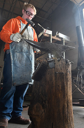 Tabor Washburn works a piece of steel during a blacksmith class at Autry Technology Center Saturday March 10, 2018. (Billy Hefton / Enid News & Eagle)