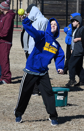 Seven Reynolds competes in the softball throw during the Special Olympics at Vance Air Force Base Wednesday March 7, 2018. (Billy Hefton / Enid News & Eagle)