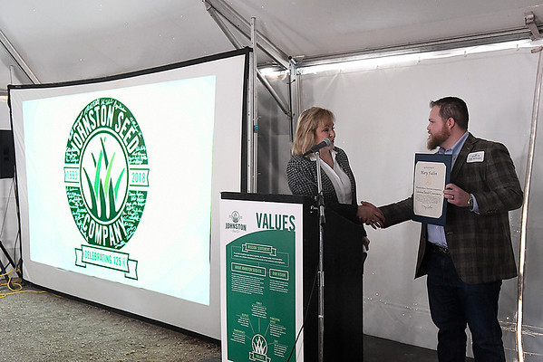 Johnston Seed Company CEO, Joey Meibergan, shakes hands with Oklahoma Governor Mary Fallin after receiving a proclamation honoring the company on it's 125th anniversary during a ceremony Friday March 9, 2018. (Billy Hefton / Enid News & Eagle)