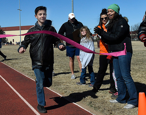 Trenton Granger wins the 400 meter run during the Special Olympics at Vance Air Force Base Wednesday March 7, 2018. (Billy Hefton / Enid News & Eagle)