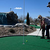 Tracy and Barbara Davidson play a round with their grandson, Brooks, on the new miniature golf course at 4RKids following a ribbon cutting ceremony Friday March 16, 2018. (Billy Hefton / Enid News & Eagle)